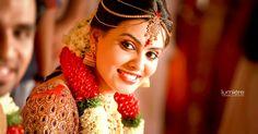 South Indian bride. Gold Indian bridal jewelry.Temple jewelry. Jhumkis. Red silk kanchipuram sari.Braid with fresh flowers. Tamil bride. Telugu bride. Kannada bride. Hindu bride. Malayalee bride.Kerala bride.South Indian wedding