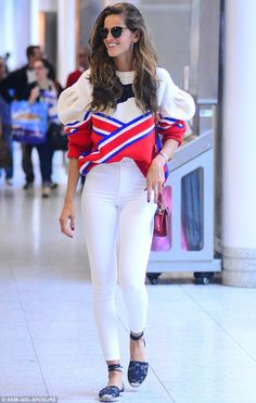 Going out on a high:Izabel Goulart wore a wide grin as she got ready to fly out of Rio de Janeiro on Monday