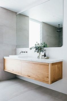 This gorgeous custom floating timber vanity made f .This gorgeous custom floating timber vanity made f . - Custom Floating Gorgeous mirror timber Luxurious Coastal Home: Kyal and Long Minimal Bathroom, Modern Bathroom Design, Bathroom Interior Design, Interior Ideas, Bathroom Designs, Contemporary Bathrooms, Modern Interior, Blue Modern Bathrooms, Spa Interior