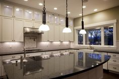 center island with drop lights is really nice...dark contrasting countertop is gorgeous R PIN