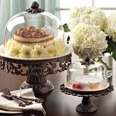 GG Collection Covered Dessert Pedestal - Cream. Showcase your confections in style with this gorgeous old world style Dessert pedestal. These petite handcrafted pedestals from the GG Collection beautifully display and serve cheese or Desserts. Handcrafted aluminum pedestal with ceramic plate and glass dome makes a lovely presentation for dinning or buffets. The ceramic plate is removable and dishwasher, oven and microwave safe.