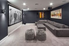 90 Home Theater & Media Room Ideas (Photos) This home boasts a large home theater with black walls paired with a gray sofa set on top of the gray carpet flooring. Basement Movie Room, Movie Theater Rooms, Home Cinema Room, Cinema Room Small, Small Movie Room, Home Theater Basement, Theater Room Decor, Movie Rooms, Basement Bedrooms
