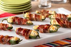 These cheesy, bacon-wrapped jalapeños are creamy, crispy, spicy and yummy. (That's just our humble opinion!) How's that for the perfect appetizer?
