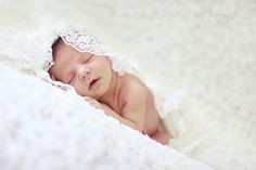 baby girl in moms wedding veil
