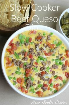 Slow Cooker Beef Queso Dip is a great appetizer for you're next party or for snacking during the big game.