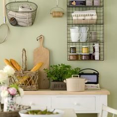 Kitchen shelving. This kitchen has an industrial-country feel with muted heritage colours and wire storage. Paint, Little Greene.