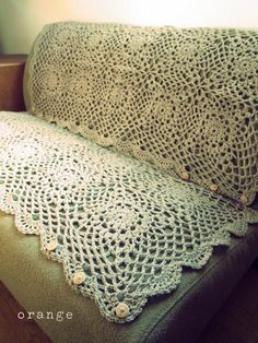 Orange, crochet sofa cover
