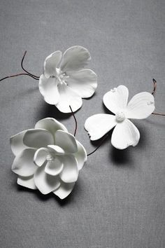 Porcelain Bloom - make from modeling clay and adhere to wall with cherry tree.
