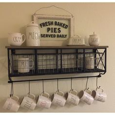 """""""Some of my #RaeDunn collection is looking gorgeous thanks to Hobby Lobby! I scored this shelf with baskets and hooks for 50% off online Where's my…"""""""