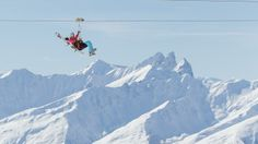 The world's highest zipline, La Tyrolienne, spans the Maurienne and Taretaise valleys in the French Alps. (C. Cattin OT Val Thorens)