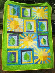 The Summer Solstice Quilt...sunshine and leaves, what more can you ask for?...paper pieced suns and machine appliqued leaves JSYK.