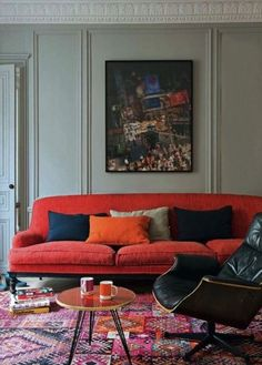 love the sage green wall with the bright orange and reds
