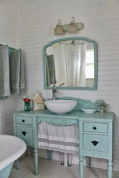 Old vanity repurposed as a sink. Love the color as well