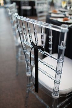 Lucite chairs with simple black ribbon. Lucite Chairs, Chiavari Chairs, Wedding Table Decorations, Wedding Chairs, Tiffany Chair, Clear Chairs, Ghost Chairs, Wedding Events, Wedding Receptions