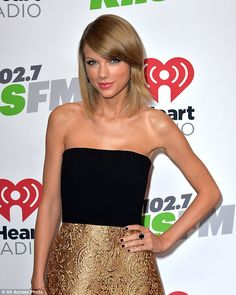 Taylor Swift at the 2014 Jingle Bell Ball. Take a look at her performance outfit here: http://dailym.ai/1wIAzpg