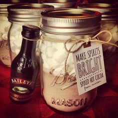 Spiked hot chocolate mix in mason jar, topped with mini marshmallows & mini bottle of Baileys attached. Making Spirits Bright.