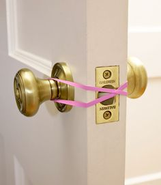 "Coming in and out with your hands full? Loop a single rubber band around a door's inside and outside knobs, twisting it as you do so that the ""X"" presses the latch open"