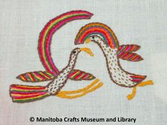Detail: Two embroidered bird motifs (focus in on the wing and tail feathers) in corner, pink scalloped edges. Embroidered Bird, Scalloped Edge, Friendship Bracelets, Feathers, Wings, Corner, Embroidery, Detail, Needlepoint