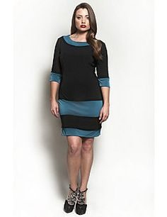 The Riella?Dress in Teal.?Is it the classic boatneck design, the sexy tri-sleeve or the boldness of the teal panel accents that make the Riella?the most contemporary dress this season? Queen Grace is known for our fashion forward designs for the plus size woman, and this dress is no exception... body hugging black fabric with perfectly placed teal color blocking, and a hemline just above the knee tells anyone who sees you that you are a woman of modern style. Tell the world you are a woman…