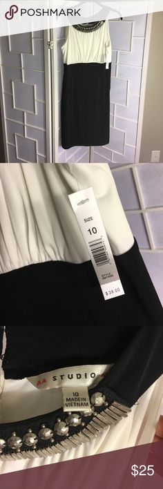 NWT BLACK AND WHITE DRESS Black and off white dress with beaded accent around the neck line.  NWT ( new with tags and never worn ) has small hole where stitching came loose but you can see through it because of the slip.  When it hangs you can't even tell. See last pic Aa Studio Dresses