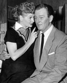 Publicity photo of John Wayne and Lucille Ball from the television program I Love Lucy. 3 October Photo by:CBS Television. Lucille Ball wearing black, short-sleeved dress with collar. drawn-on eyebrows, thick and long lashes, bold lipstick. Hollywood Stars, Classic Hollywood, Old Hollywood, Hollywood Bedroom, Hollywood Images, Divas, Iowa, I Love Lucy Show, Viejo Hollywood