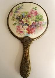 Vintage Hand Mirror- My Mother gave me one much like this when I was younger and somehow I have lost it