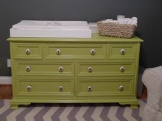 colored dresser with accent knobs