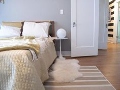 Whether your bedroom is covered in carpet or hardwood, rugs are a great way to add color, texture and of course, warmth underfoot. Try layering rugs in different shapes and patterns for an extra-comfy look.