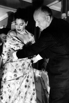 """Christian Dior with Ava Gardner at a costume fitting for her film """"The Little…"""
