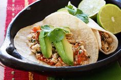 Cilantro Lime Tilapia Tacos - Flaky white fish, tomatoes, jalapeños, cilantro and lime topped with avocado. A fresh and flavorful way to spice up fish, quick enough to make for a busy weeknight!