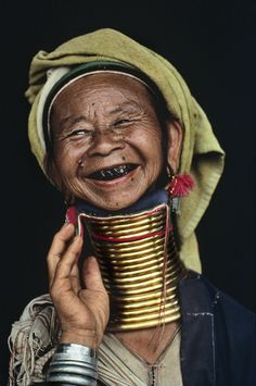In the mountains between Burma and Thailand live the Padaung women, who wear rings around their necks. What appears to be many rings is actually a single brass coil. The first coil is applied when the girl is five. As the child grows up, one coil is replaced with another, longer coil. This practice presses the clavicle and the rib cage together, giving the appearance that the neck is elongated.