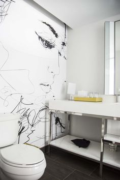 Modern bathroom with black and white mural at the Renaissance airport hotel in Atlanta on Thou Swell @thouswellblog