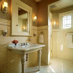 Artful Tile for Kitchen & Bath  by PATRICIA POORE. The white-tiled bath, here with hex floor tiles and a high wainscot of subway tiles, is a Belle Epoque classic enjoying a revival. The 1920s look works for houses 1890–1930s. Photo by Karen Melvin.