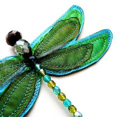 Fabric and bead dragonfly.... Can paste it on a simple clip...  Voila a cute clip!  Or a barrette!