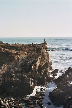 Standing on the edge of a cliff