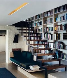open stair with floating bench seating below with bookcase