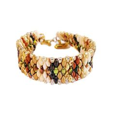 This gradient superduo bracelet incorporates both earthy and lux in an ombre pattern. The colors are arranged to replicate a snakeskin pattern. It is a very unique piece. It has a beautiful reflective