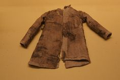 8-9th century Moshchevaya Balka burial. Canvas, linen and silk (previously with fur) Womens ( small girl/doll) outer coat. Copy of adult clothing.