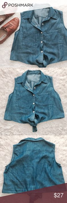 Chambray Sleeveless Tie Front Crop Top Collared neck. Button down. Double front pockets. Pearly white colored snap buttons.   MEASUREMENTS (laying flat) Armpit to armpit: 18in Shoulder to hem: 15.5in  •USE OFFER FEATURE TO NEGOTIATE  •BUNDLE TO SAVE  •NO OUTSIDE TRANSACTIONS •NO TRADES Tops Crop Tops