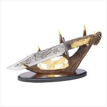 "Mountain Eagle Display Knife - Bring the Eagle Spirit into your home with this dramatic display dagger! Rich etched graphics adorn the blade, while lifelike carvings beautify the faux antler handle. A stunning centerpiece for any outdoorsman's collection! Decorative purposes only.  Weight 2 lbs. Stainless steel, polyresin and wood base. 12-1/2"" x 4-1/8"" x 7-5/8"" high."