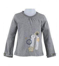 100% cotton knit solid color long sleeve tunic top with gathered neck, front crochet flower & torchon lace trim, front embroidered twiggy, janice floral & carnival spot print flower appliques, embroidery trim and ruffled twiggy print band trim on lower arms. Length finishes at hip. Machine washable. Imported.