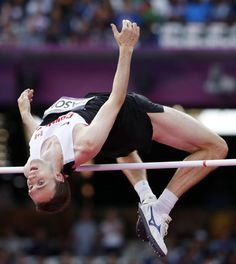 Canada's Michael Mason competes in a men's high jump qualification during the athletics in the Olympic Stadium at the 2012 Summer Olympics, London, Sunday, Aug. 5, 2012.