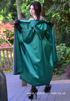 This sexy babe is showing off her long and luxurious Rubber Rainwear!