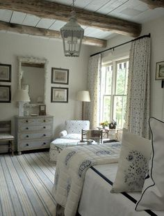 Guest bedroom. in blue and creamy white. Latern fixture. Bonny Neiman