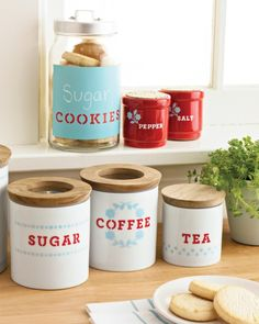 Use stencils to label inexpensive porcelain kitchen containers for easy access. No more rummaging around for the flour and sugar!