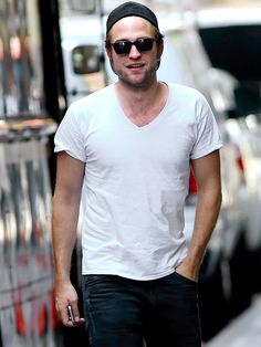 Summer may be winding down, but Robert Pattinson, in a simple white tee and shades, steams up the streets of New York City during a walk with friends on Monday.