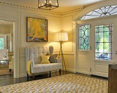 This is a beautiful foyer/entryway. And I am not a fan of yellow, but this is such a lovely buttery shade and a great front door!
