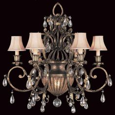 This chandelier with a lighted central bowl is adorned with moon-dusted cut crystal pendants.CALL TOLL-FREE 1-866-339-5060 FOR BEST PRICE.