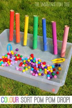 Colour sorting pom pom drop game- could add mini baskets with numbers for a counting challenge.