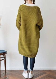 Back side view of model in open front knit cardigan